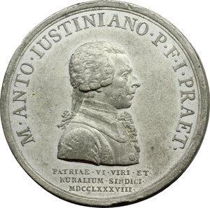 obverse: Marcantonio Giustinian (1741- ), Luogotenente della patria del Friuli. Medaglia coniata 1788.  D/ M. ANTO. IVSTINIANO P. F. I. PRAET. Busto a destra, sotto, PATRIAE VI VIRI ET/ RVRALIVM SINDICI/ MDCCLXXXVIII. R/ OB ITER VIATORUM TUTUM ET SEGURIT PUB RESTITUTAM. Armi; all esergo, ARMA DOMITIS LATRONI/ EXTORTA. Volt. 1710. MB.   mm. 46.70 Inc. Ignaz Donner.  Segnetti, colpo al ciglio. BB. Il Giustinian viene ricordato principalmente per aver debellato la piaga del banditismo dall Alto Friuli. Egli infatti condusse una felice campagna contro i ladroni Pagnutti che, dalla  casa dei corvi  presso Gemona, scendevano a terrorizzare il Friuli. I due capibanda, Pressa e Zefon furono impiccati. La prima medaglia, dedicata al Giustinian dai sei Deputati della Patria e dagli otto Sindaci  della Contadinanza, ricorda appunto la sconfitta di questi banditi di cui vengono raffigurate le armi, in particolare i temibili fucili  scavezzi .