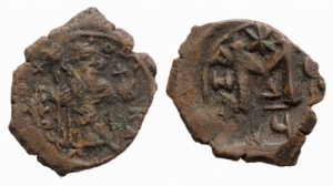 D/ Constans II (641-668). Æ 40 Nummi 4.54gr. Constantinople, RY 12 (652/3). Constans standing facing, holding long cross and globus cruciger. R/ Large M; cross above, A/N/A N/Є/O/ς across field, XII in exergue; Δ. MIB 170b; DOC 70b; Sear 1007. Brown patina, near Very Fine
