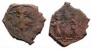 D/ Constans II (641-668). Æ 40 Nummi 3.59gr. Constantinople, RY 12 (652/3). Constans standing facing, holding long cross and globus cruciger. R/ Large M; cross above, A/N/A N/Є/O/ς across field, XII in exergue; Δ. MIB 170b; DOC 70b; Sear 1007. Brown patina, near Very Fine