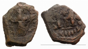 D/ Constans II (641-668). Æ 40 Nummi 4.03gr, Constantinople, RY 12 (652/3). Constans standing facing, holding long cross and globus cruciger. R/ Large M; cross above, A/N/A N/Є/O/ς across field, XII in exergue; Δ. MIB 170b; DOC 70b; Sear 1007. Brown patina, near Very Fine