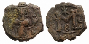 D/ Constans II (641-668). Æ 40 Nummi 5.37gr.. Constantinople. Constans standing facing, holding long cross. R/ Constantine IV, Heraclius and Tiberius standing facing, each holding globus cruciger. MIB 175; DOC 82-6; Sear 1011. Brown patina, Good Fine - near Very Fine