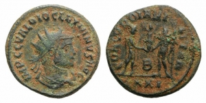 D/ Diocletian (284-305). Radiate (21mm, 3.46g, 12h). Cyzicus. Radiate and draped bust r. R/ Diocletian standing r., holding sceptre and receiving Victory on globe from Jupiter standing l., holding long sceptre; B/XXI•. RIC V pt. 2, 306. VF