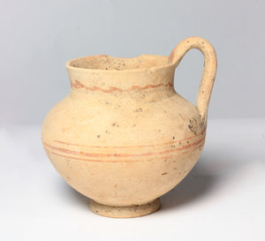 D/  Daunian Pottery olpe. Bulbous body, strap handle, flared rim and painted reddish-brown bands. Duania, 3rd century BC. H. 12 cm (with handle).