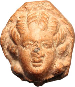 D/  Hellenistic terracotta head of a woman. Circa 3rd Century BC. H. 30 mm.