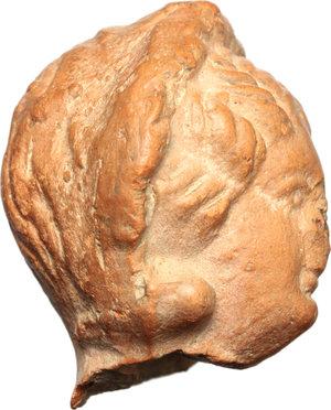 R/  Hellenistic terracotta head of a woman. Circa 3rd Century BC. H. 30 mm.