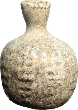 D/  Late roman glass bottle, blown into a mould. With white patina. 5th-6th century AD. H. 6,5 cm.