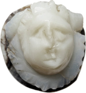 D/  Facing Gorgoneion. Agate cameo, with black and white layers. Roman Period, 2nd-3rd century AD. 14 x 13 x 10 mm. Bold reliefs.