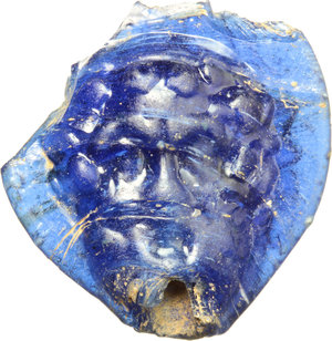 R/  A blue glass seal with facing satyrs. Greek, 5th-4th century BC. 24 x 23 mm.