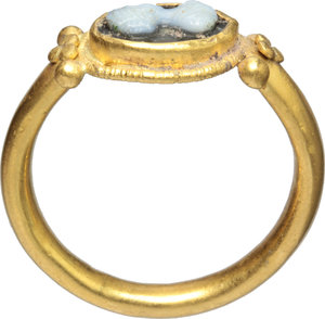 R/  Gold ring, the bezel with cameo depicting young lady resembling Faustina Minor. Roman period, 2nd century AD. 27 mm. 5.4 g.