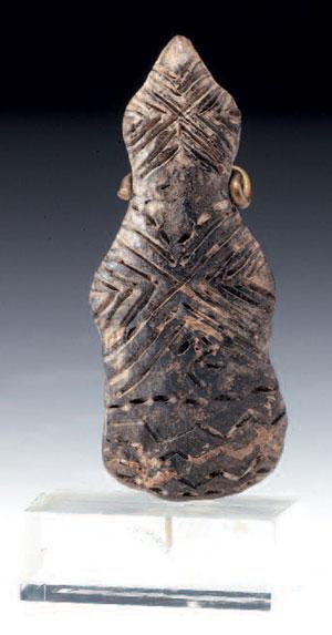 obverse: Idolo a violino Materia e tecnica: terracotta incisa e model