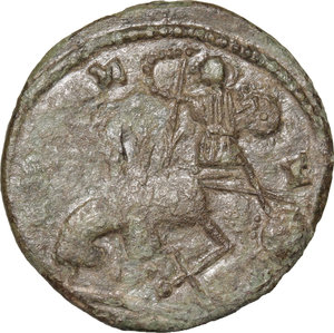 R/ Barbaric Coinage.  AE Follis.  D/ Bust right, bare, draped. R/ Battle-scene between foot-soldier and horseman.  AE. g. 4.53  mm. 22.00    About VF.