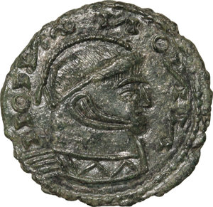 D/ Barbaric Coinage.  AE Follis.  D/ Head of Constantine I. right, helmeted, cuirassed. R/ Two Victoriae standing facing each other and holding shield supported by altar.  AE. g. 2.23  mm. 18.00   Fantasy inscriptions. About VF.