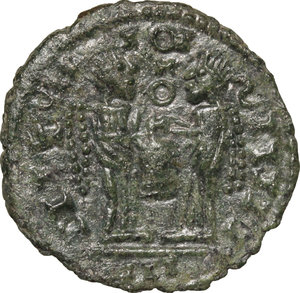 R/ Barbaric Coinage.  AE Follis.  D/ Head of Constantine I. right, helmeted, cuirassed. R/ Two Victoriae standing facing each other and holding shield supported by altar.  AE. g. 2.23  mm. 18.00   Fantasy inscriptions. About VF.