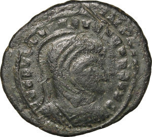D/ Barbaric Coinage.  AE Follis.  D/ Head of Constantine I. right, helmeted and cuirassed. R/ Two Victoriae standing facing each other and holding shield supported by altar.  AE. g. 3.12  mm. 22.00   Fantasy inscriptions. About VF.