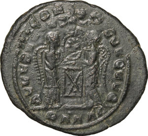 R/ Barbaric Coinage.  AE Follis.  D/ Head of Constantine I. right, helmeted and cuirassed. R/ Two Victoriae standing facing each other and holding shield supported by altar.  AE. g. 3.12  mm. 22.00   Fantasy inscriptions. About VF.
