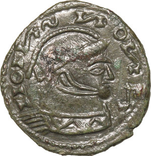 D/ Barbaric Coinage.  AE Follis.  D/ Head of Constantine I. right, helmeted and cuirassed. R/ Two Victoriae standing facing each other and holding shield supported by altar.  AE. g. 2.46  mm. 18.00    About VF.