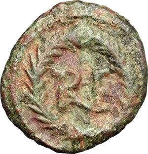 R/ Theoderic (475-526). AE Decanummium, Ravenna mint, 512-522.  D/ Bust of Ravenna right, turreted, draped. R/ City-monogram in wreath. MIB 72a. AE. g. 2.84  mm. 11.50  R.  Good F.