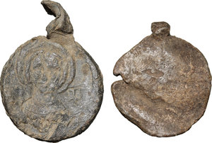 D/  Lot of 2 Byzantine bullae.     PB.     On both pieces traces of another bulla attached. F.