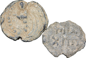 D/  Lot of 2 Byzantine bullae.     PB.     One with monogram and one with religious picture. F.