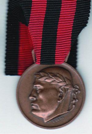 obverse: RSI - D/ Busto Mussolini laureato