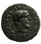 obverse: Impero Romano. Traiano. 98-117. d.C. Quadrante. Ae. D\ IMP CAES TRAIAN AVG GERMBusto di Ercole verso destra R\ Bastone ai lati SC. Ric 701. Peso2,64 gr. Diametro15 mm. MB+. Patina verde.