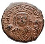 obverse: Bizantini - Maurizio Tiberio. 582-602 d.C. Follis (40 Nummi). Ae. Antiochia. 595-596 d.C. D/ Busto frontale con veste consolare. R/ Grande M ANN XIII. Peso gr. 10,7. Diametro mm. 27,2. Buon BB+.