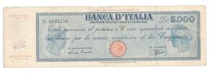 """D/ CARTAMONETA. REPUBBLICA SOCIALE ITALIANA. Titolo Provvisorio da 5.000 Lire """"Luogotenenza"""". N. 194,754. Decr.M. 30.07.1896 e 07.08.1943. (Gov. Einaudi). BI 750. (Certificato Nasi W.). Piccoli taglietti.                            Rarissimo (R4) qBB"""