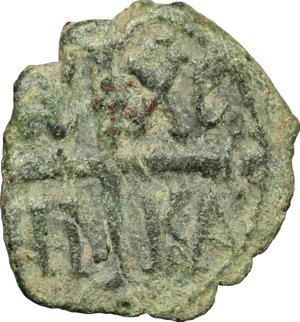 reverse: Messina.  Ruggero II, Duca Normanno (1105-1154), primo interregno (?). Follaro con Ruggero in trono (1127-1140)