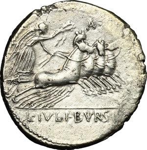R/ L. Iulius Bursio. AR Denarius, 85 BC.  D/ Male head right with attributes of Apollo, Mercury and Neptune; behind, flower. R/ Victoria in quadriga right. Cr. 352/1. AR. g. 3.91  mm. 19.00    Good VF/VF.