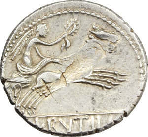 R/ L. Rutilius Flaccus. AR Denarius, 77 BC.  D/ Helmeted head of Roma right; behind, FLAC. R/ Victory in biga right, holding reins and wreath; in exergue, L. RVTILI. Cr. 387/1. B. 1. AR. g. 3.64  mm. 18.00   Metal flaw on reverse, otherwise good VF. The gash across the reverse surface is an 'adjustment al marco'. (C. Stannard 'The adjustment al marco of the weight of Roman Republican denarii blanks by gouging' in 'Metallurgy in numismatics vol 3' Royal Numismatic Society, 1993).