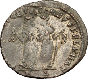 R/ Maximianus (286-310). AE Follis, Carthage mint, 299-303.  D/ Head of Maximianus right, laureate. R/ Carthago standing facing, head left, holding fruits in both hands. RIC 31b. AE. g. 7.80  mm. 29.50   Dark brown patina. About VF/F. A rare mistrike on the reverse: the double-struck with the same die axis resulted in two figures standing side-by-side.