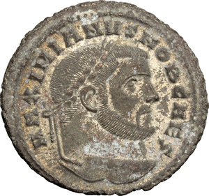 D/ Galerius as Caesar (293-305). AE Follis, Carthage mint, 298-299.  D/ Head of Galierus right, laureate. R/ Carthago standing facing, head left; holding fruits in both hands. RIC 30b. AE. g. 11.48  mm. 28.00   Nice portrait. About VF/F.