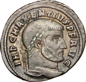 D/ Maxentius (306-312). AE follis, Ostia mint, 309-312.  D/ Head of Maxentius right, laureate. R/ Castor and Pollux standing facing each other; holding scepter with outer hand and bridled horse with inner hand. RIC 35. AE. g. 6.81  mm. 27.00    About VF.