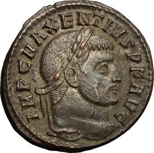 D/ Maxentius (306-312). AE follis, Ostia mint, 309-312.  D/ Head of Maxentius right, laureate. R/ Fides standing left; holding standard in each hand. RIC 45. AE. g. 7.25  mm. 25.00   Sharply struck. Good VF.