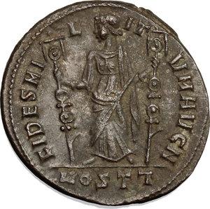 R/ Maxentius (306-312). AE follis, Ostia mint, 309-312.  D/ Head of Maxentius right, laureate. R/ Fides standing left; holding standard in each hand. RIC 45. AE. g. 7.25  mm. 25.00   Sharply struck. Good VF.