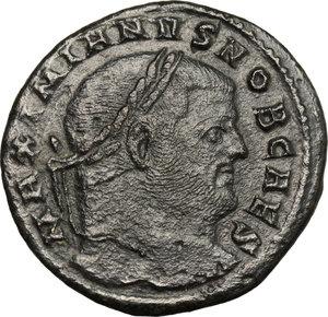 D/ Galerius (305-311). AE Follis, Aquileia mint, 303 AD.  D/ Head of Galerius right, laureate. R/ Moneta standing left; holding scales and cornucopiae. RIC 38b. AE. g. 9.05  mm. 28.00    About VF.