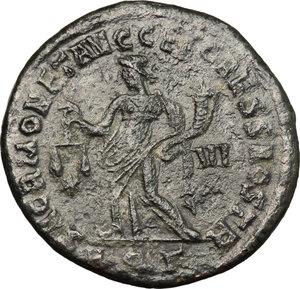 R/ Galerius (305-311). AE Follis, Aquileia mint, 303 AD.  D/ Head of Galerius right, laureate. R/ Moneta standing left; holding scales and cornucopiae. RIC 38b. AE. g. 9.05  mm. 28.00    About VF.