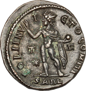 R/ Constantine I (307-337). AE follis, Arelate mint, 316 AD.  D/ Bust of Constantine right, laureate, draped, cuirassed. R/ Sol standing left, wearing chlamys on left shoulder, raising right hand and holding in left globe. RIC 81. AE. g. 3.89  mm. 20.00    About VF.