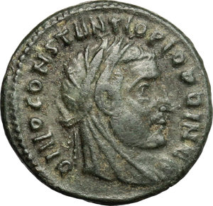 D/ Licinius I (308-324). AE fraction of follis, Rome mint, 317-318.  D/ Head of Constantius Chlorus right, laureate, veiled. R/ Eagle standing right, head turned left. RIC 111. AE. g. 2.26  mm. 16.00   Dark patina. About VF.