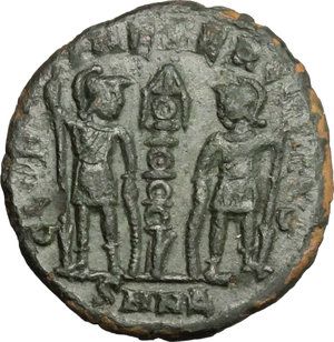 R/ Constantine II (337-340). AE 14mm, Nicomedia mint, 337-340.  D/ Head of Constantine right, diademed. R/ Two soldiers standing facing each other; holding spear and resting on shield, between, standard. RIC 6. AE. g. 1.59  mm. 14.00   Dark patina. About VF/F.
