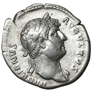 D/ Hadrian. 117-138 AD. Denarius, Rome, AD 125-128. AR 2.85 gr. – 18.3 mm. O:\ HADRIANVS - AVGVSTVS, laureate bust r., drapery on l. shoulder. R:\ COS - III, Spes standing l., raising skirt and holding flower. RIC 181; C 390. Good portrait. XF