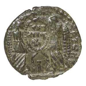 reverse: BARBARIC IMITATION. MAGNENTIUS IV° sec. AD. CENTENNIONALIS. AE 2,80 gr. – 18,87 mm. O:\ Head to right. R:\ Two Victories holding shield. RARE. XF
