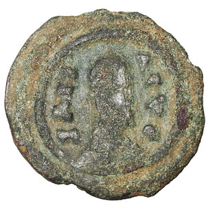 obverse: AXUM. Anonymous. AD 370. AE 15 mm - 1.22 gr, 12h. O:\ Draped bust right, wearing head-cloth. R:\ Greek cross within circle. Hahn, Aksumite 33; SACA 151-65; BMC Axum 92-244; Munro-Hay Type 52. Rare. VF+.