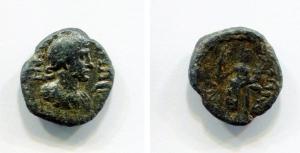 obverse: Antonino Pio (138-161). Zecca incerta. AE (14 mm. - 1,68gr.). D.\: Busto di Antonino. R.\: Figura femminile con Cornucopia e Nie (o Palladium). MB. NC.