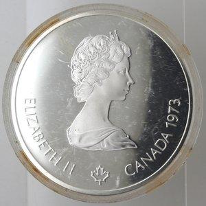 obverse: Monete Estere. Canada.Elisabetta II.10 Dollari 1973. Olimpiadi di Montreal 1976. Mappa del mondo. AG 925. Km. 86.1. FDC.Proof.