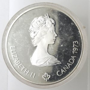 obverse: Monete Estere. Canada.Elisabetta II.5 Dollari 1973. Olimpiadi di Montreal 1976. Vele. AG 925. Km. 85. Peso gr. 24,21. Diametro mm. 38.FDC Proof.