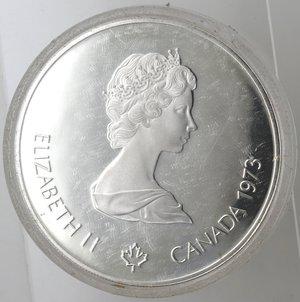 obverse: Monete Estere. Canada.Elisabetta II.5 Dollari 1973. Olimpiadi di Montreal 1976. Mappa del Nord America. AG 925. Km. 85. FDC.Proof.