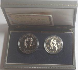 obverse: Monete Estere. Korea del Sud. Cofanetto con due monete da 2000 won e 1000 won. Ni. Km. 50.  Km. 46. FDC Proof. In confezione della zecca.