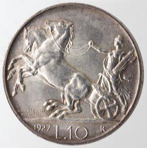 reverse: Casa Savoia. Vittorio Emanuele III. 1900-1943. 10 lire 1927 Biga due rosette. Ag. Gig. 56a. Colpetto altrimenti SPL+.