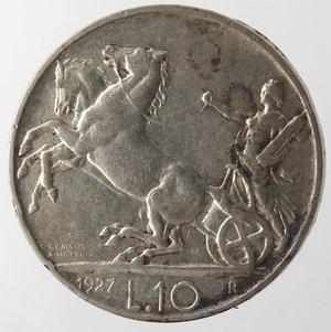 reverse: Casa Savoia. Vittorio Emanuele III. 1900-1943. 10 lire 1927 Biga due rosette. Ag. Gig. 56a. BB. Graffio al diritto.